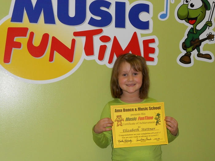 A Music FunTime student holds her certificate